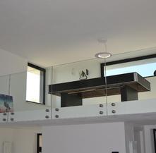 Parapetto  in vetro con fissaggio a punto per soppalco interno