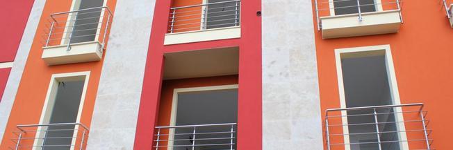 Parapetto per balconi con fissaggio laterale e pavimento in 316 satinato